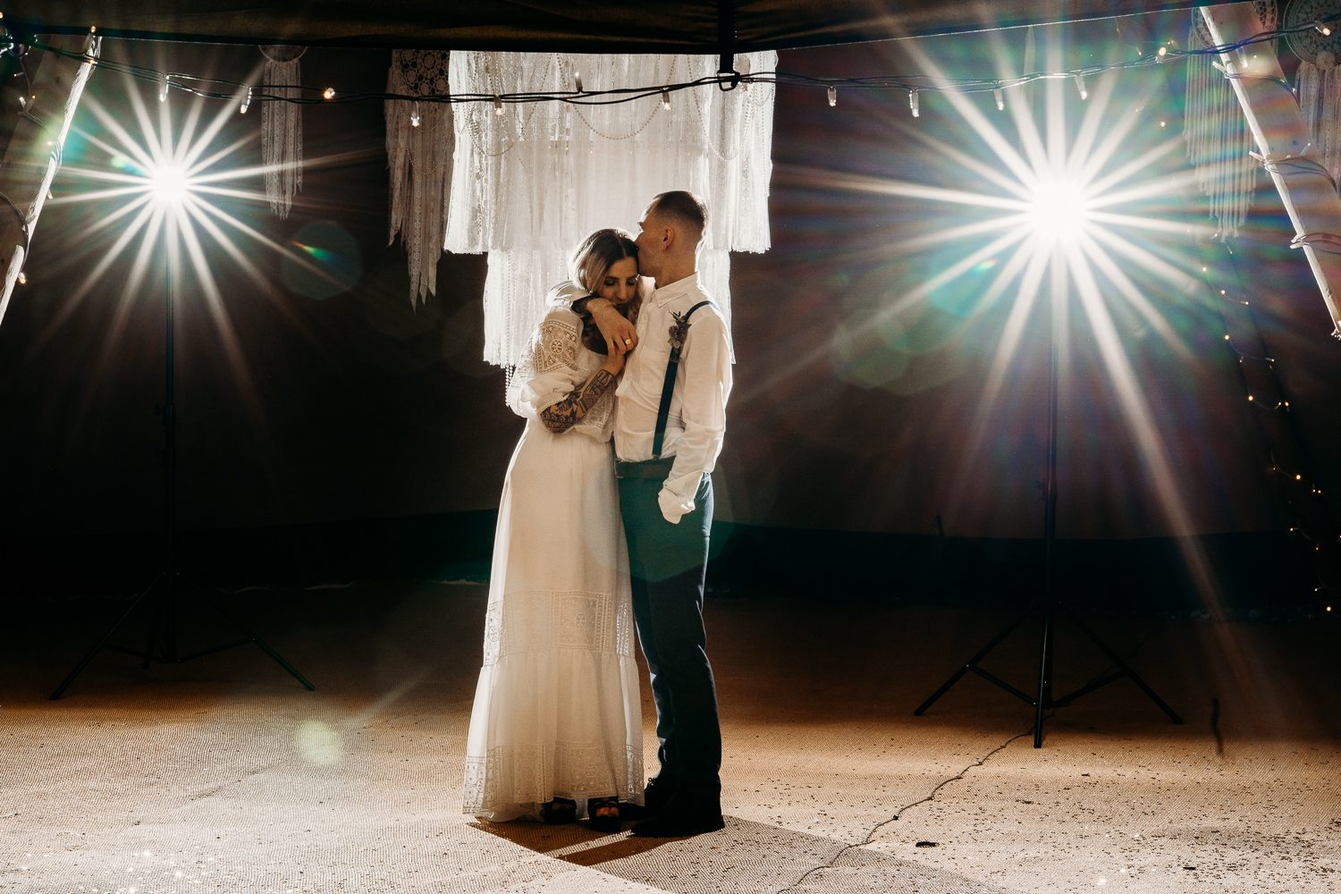 BRIDE AND GROOM AT FIRST DANCE IN TIPI