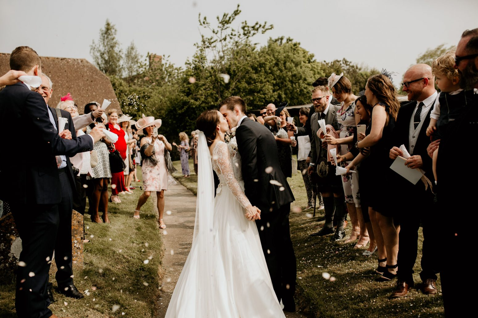 luxury manor house hotel wedding bride and groom kiss under the confetti