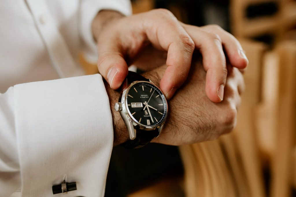 groom putting on surprise watch from groom box