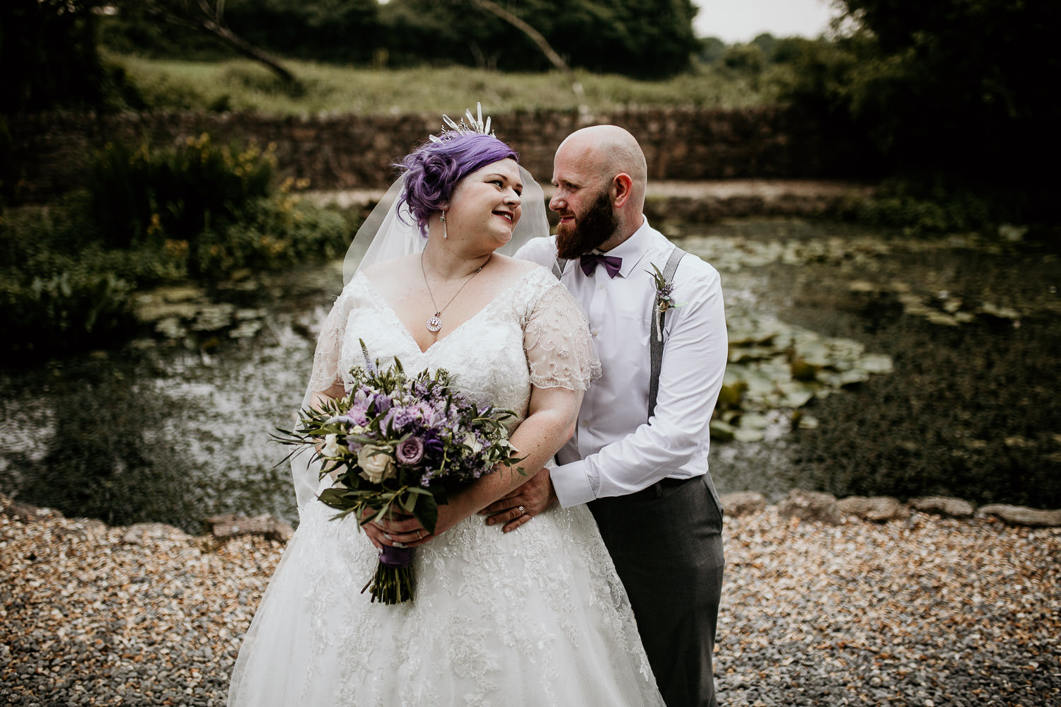 quirky alternative wedding bride and groom outside day time country side location