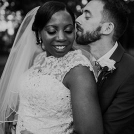 black and white personal photo of bride and groom embracing