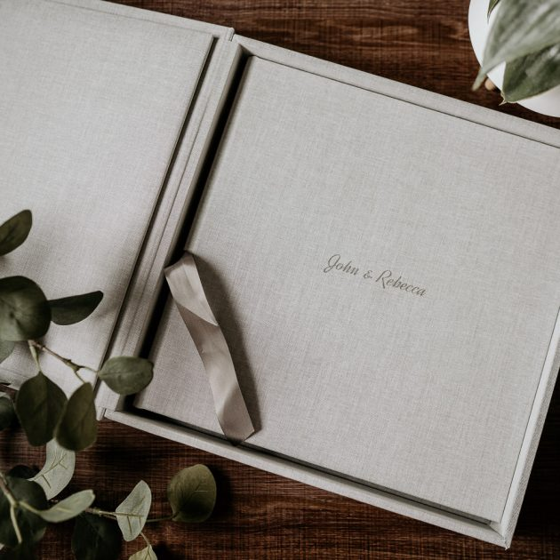 Flat lay of grey fine art wedding Photography album