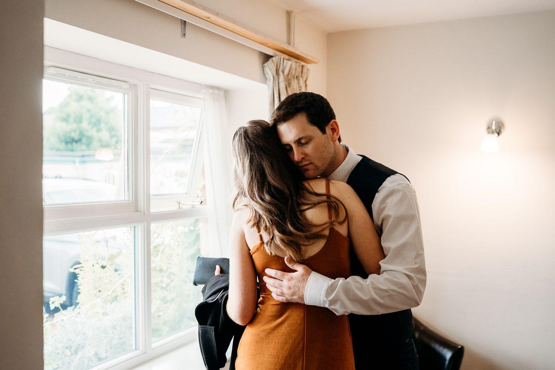 groom giving sister a hug before wedding ceremony
