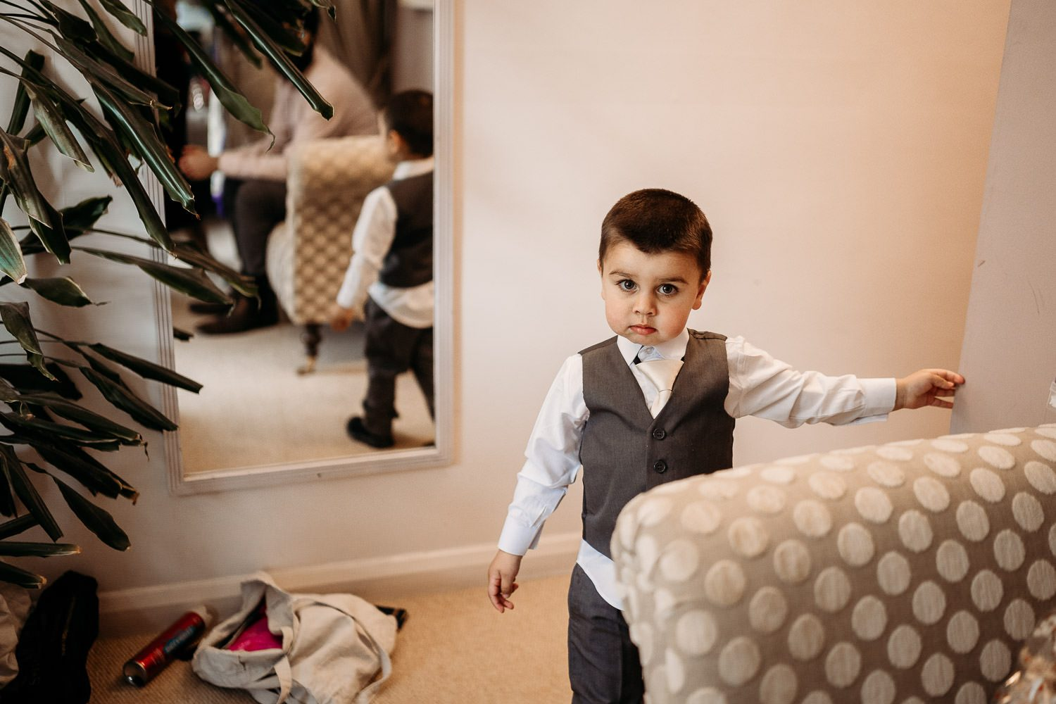 page boy smiling during bride preparations