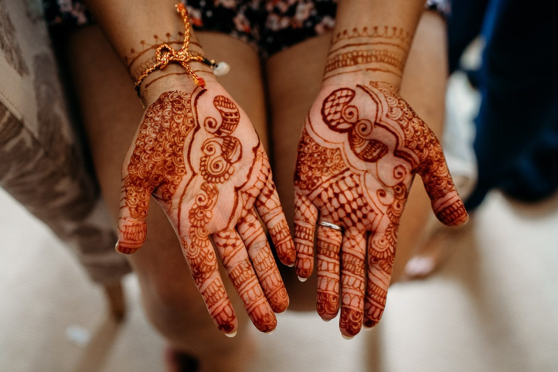 bride's henna on hands before wedding