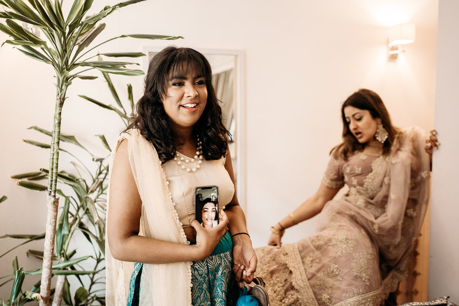 bride's friends getting ready for indian wedding