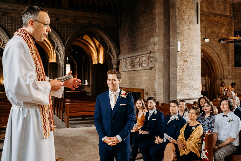groom waiting at alter at uppingham chapel