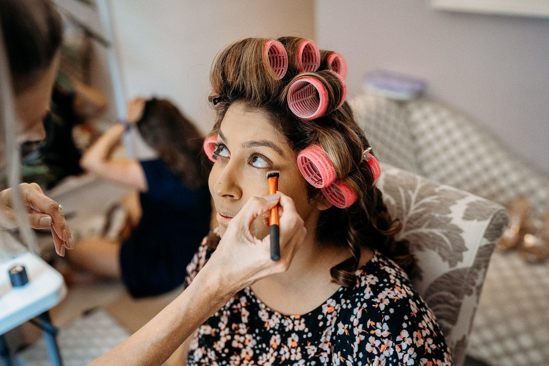 indian bride having her make up done