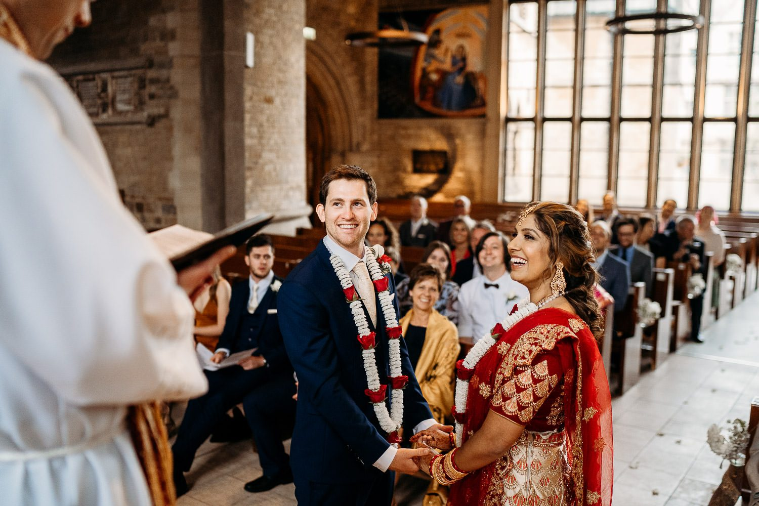 bride and groom smiling during indian wedding ceremony