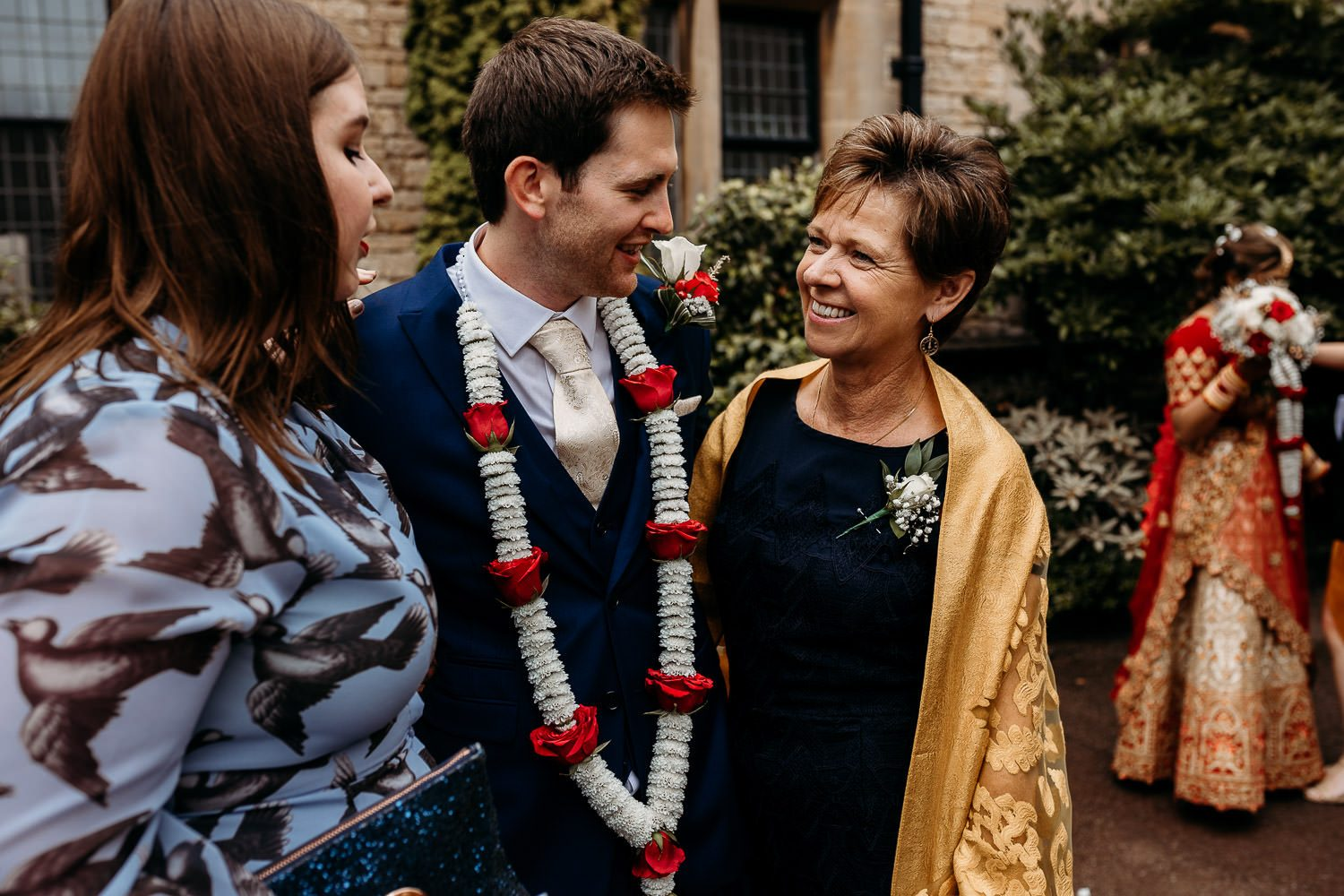 groom and groom's mother hugging at wedding ceremony