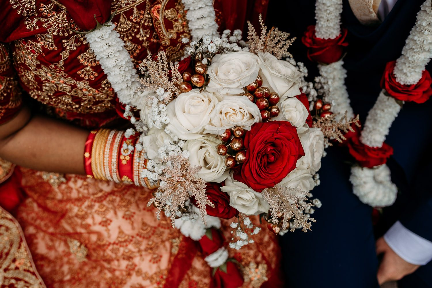 close up of brides red and white rose wedding bouquet