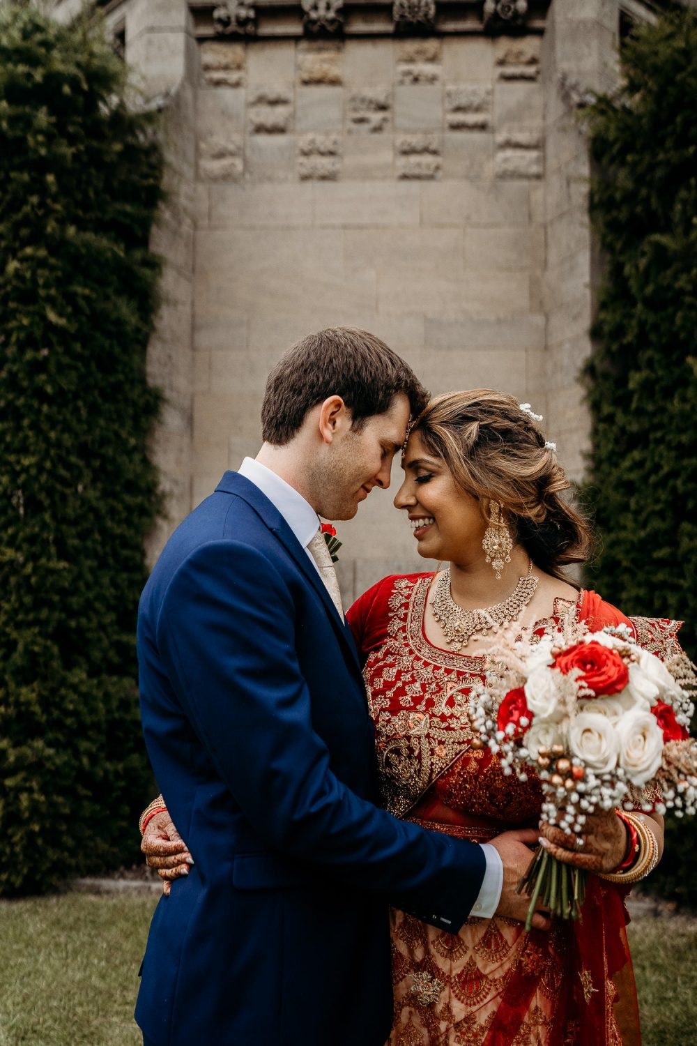 bride and groom smiling at each other outside leicester wedding venue