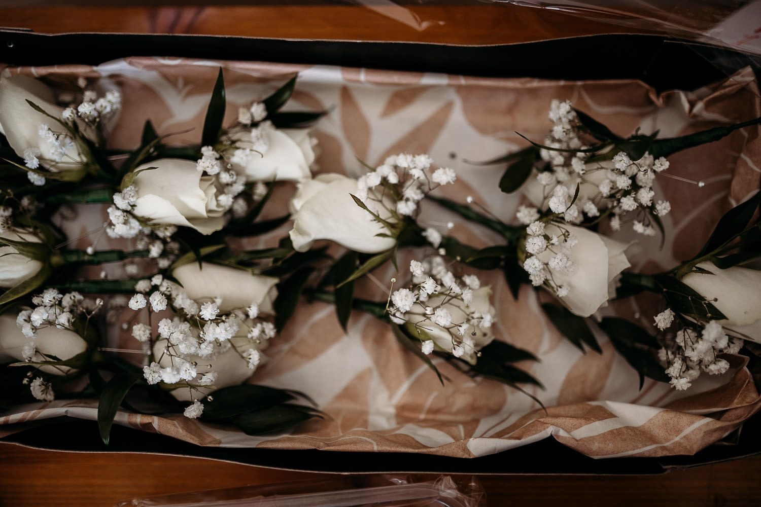 close up of rose and gypsophila buttonholes
