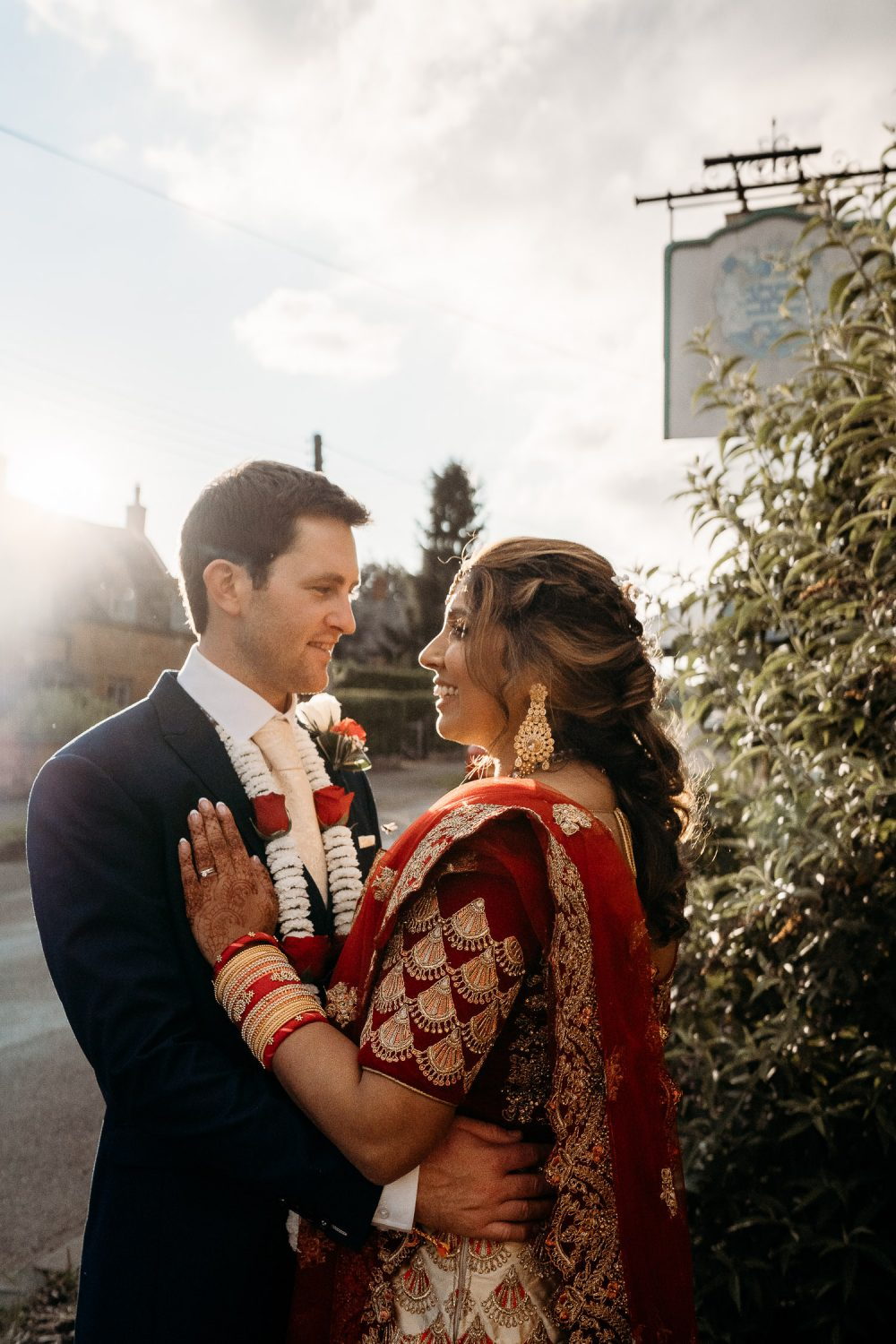 portait of indian bride and groom at sunset
