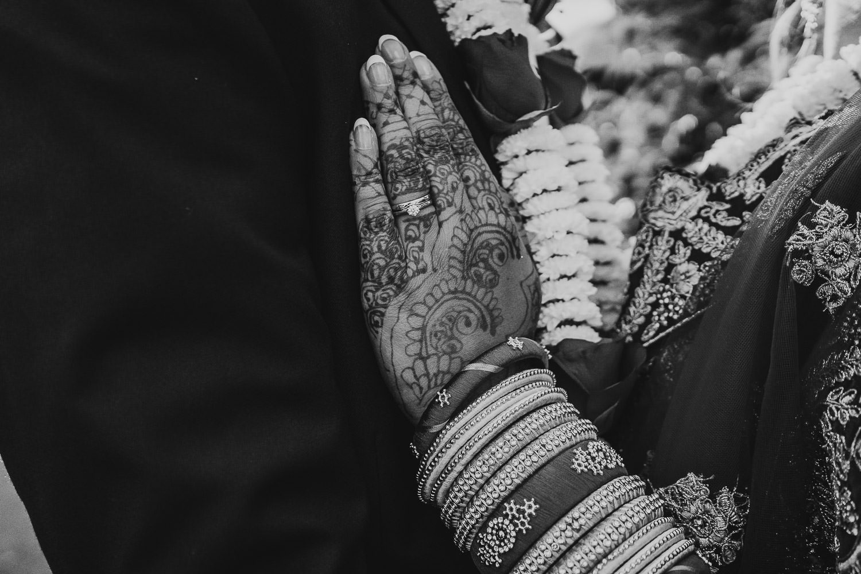 close up wededing rings on asain bride