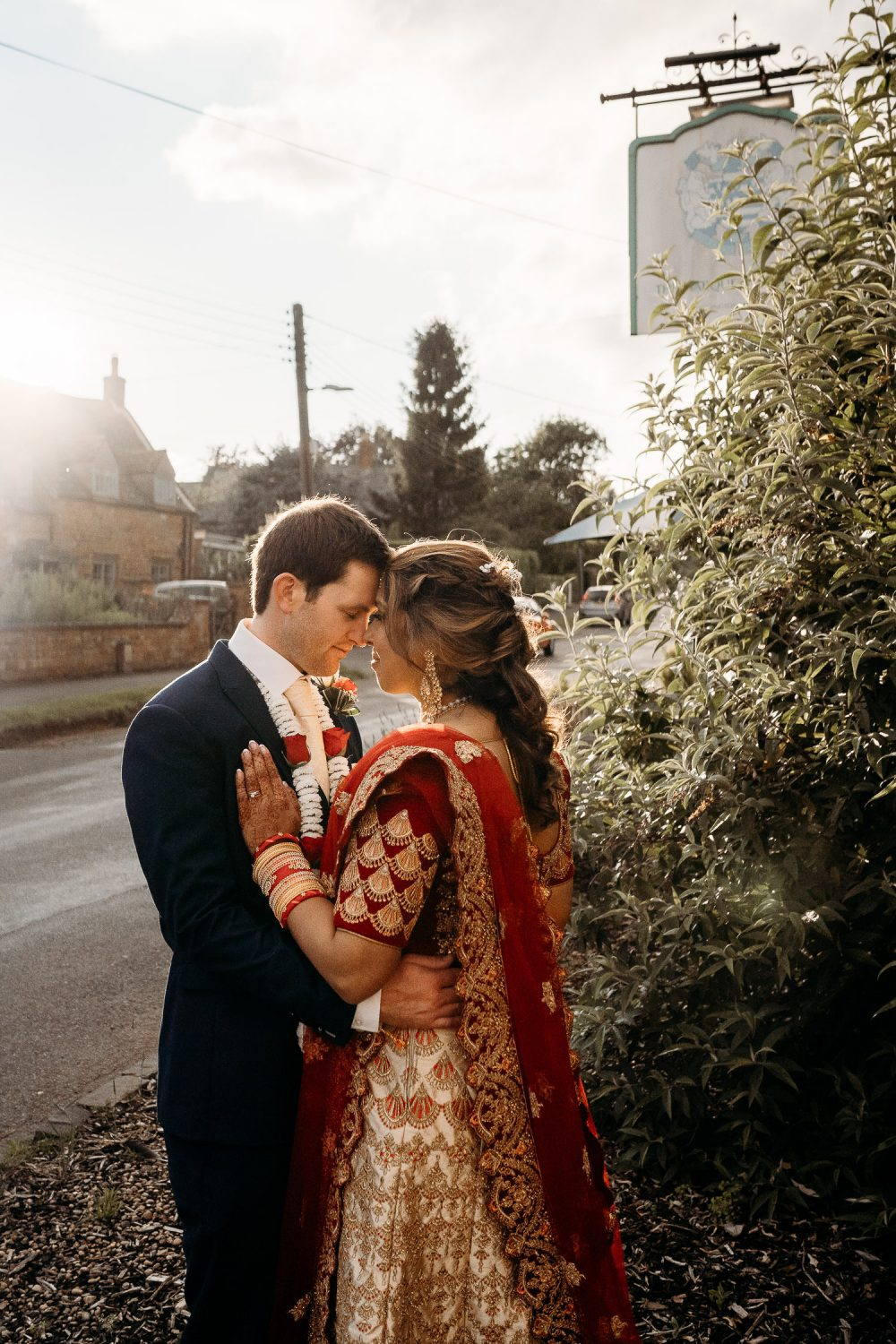 indian bride and groom during sunset in uppingham
