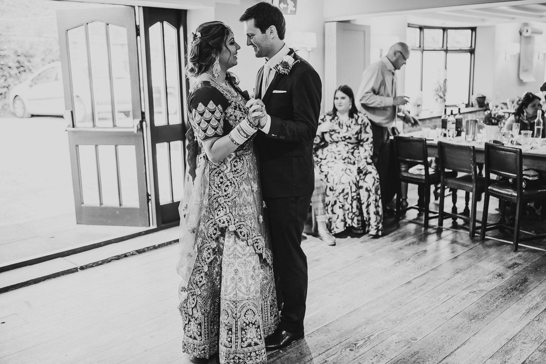 indian bride and groom dancing at weddding