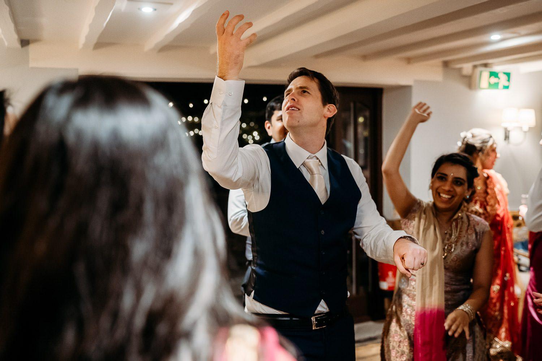 GROOM DANCING AT INDIAN WEDDING