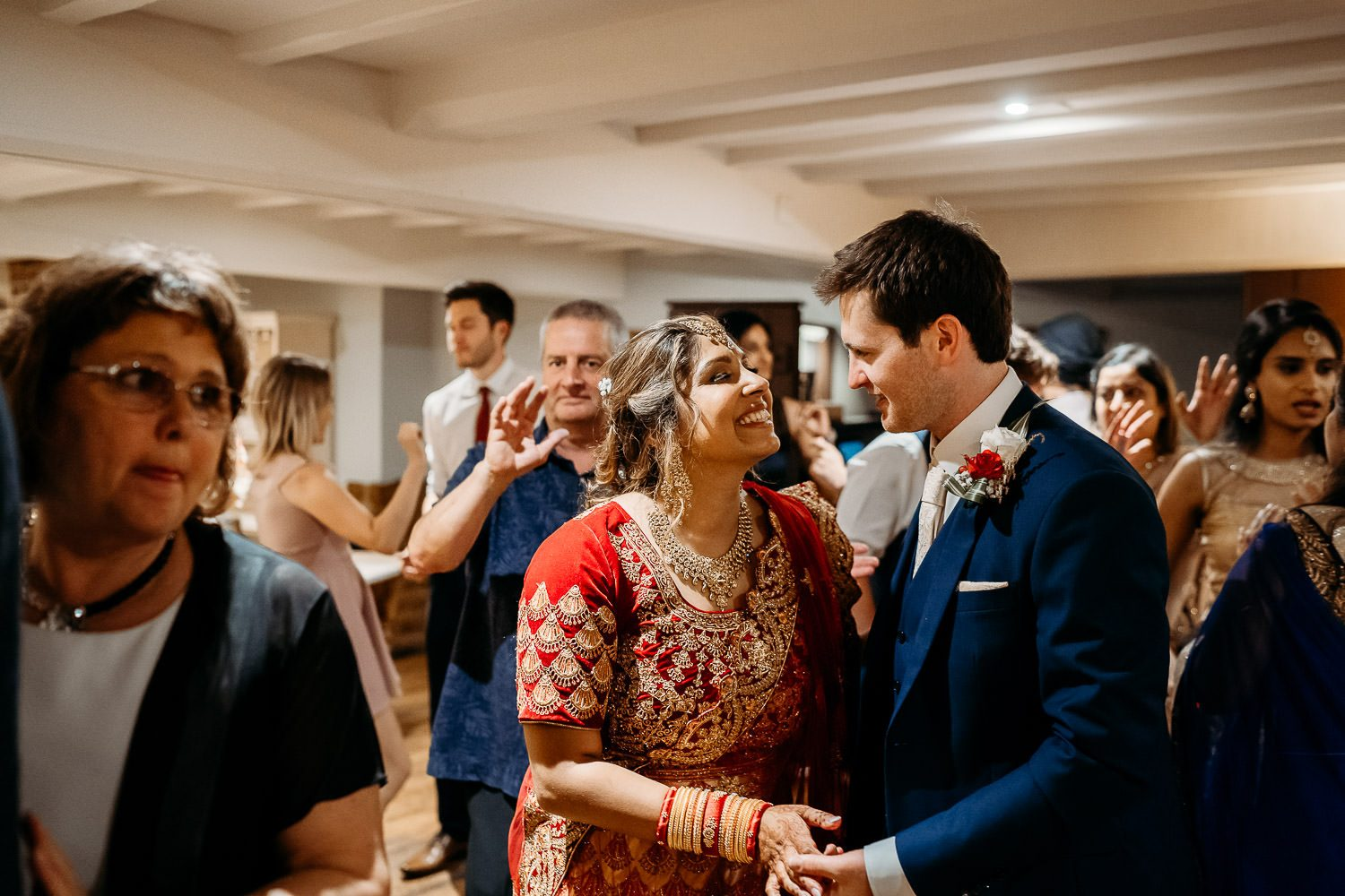 BRIDE AND GROOM DANCING DURING INDIAN WEDDING IN LEICESTER