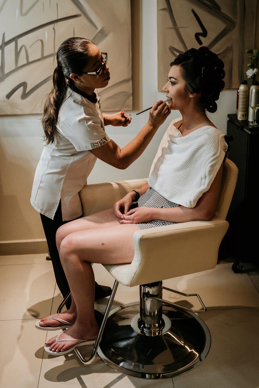 bride having make up done in royalton spa