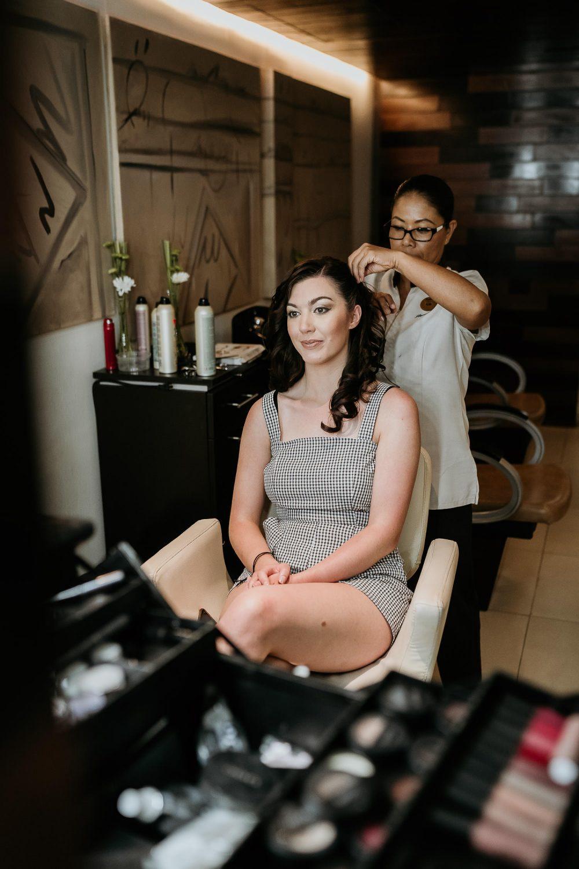 bride having her hair done at royalton riviera spa cancun