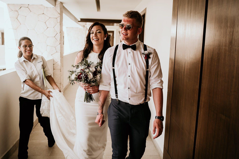 groomsmen escorting bride to sky terrace ceremony at royalton riviera