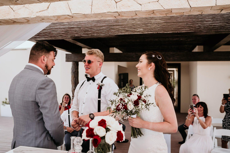 emotional groomsmen crying during wedding ceremony