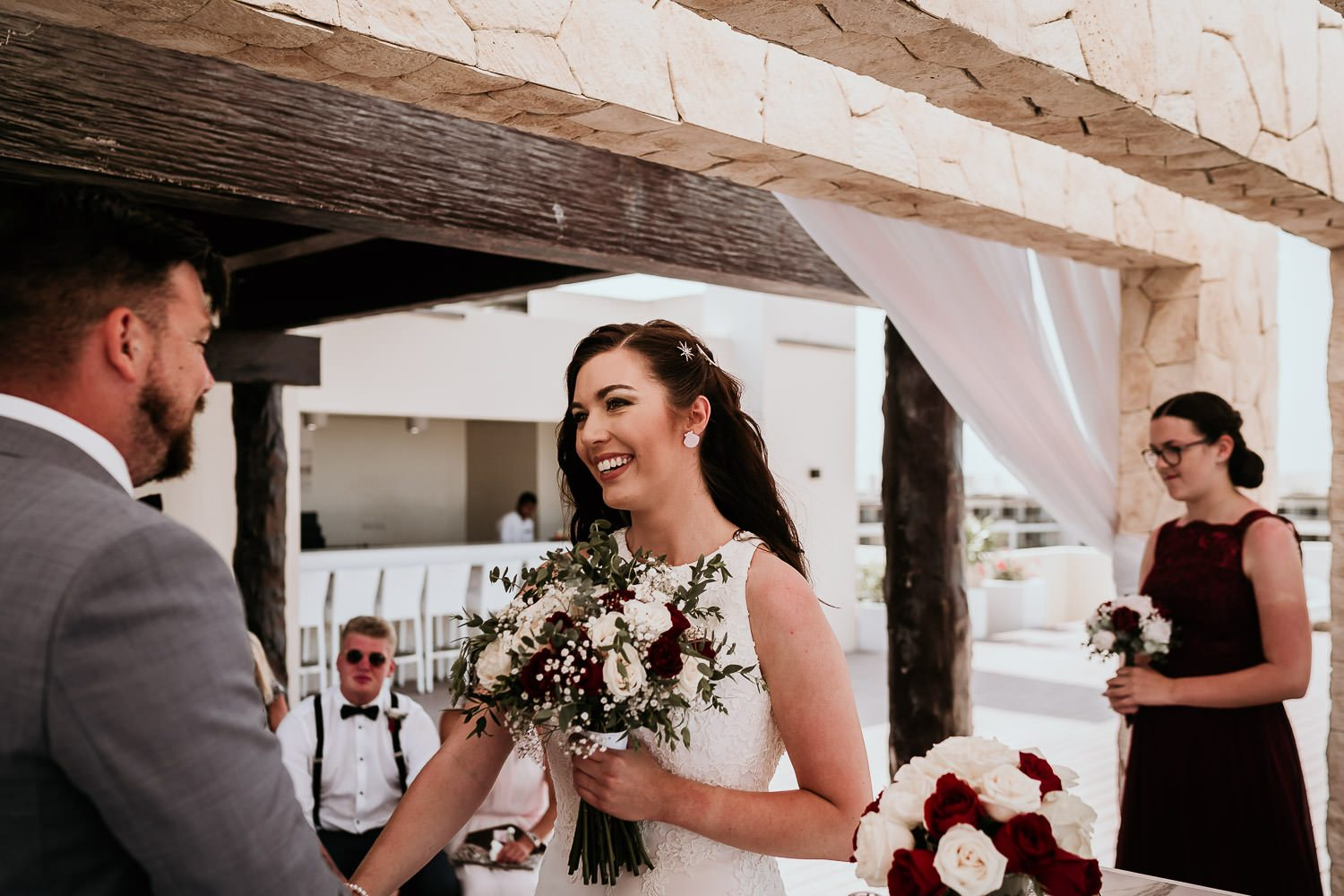 bride smiling at groom during cancun wedding ceremony