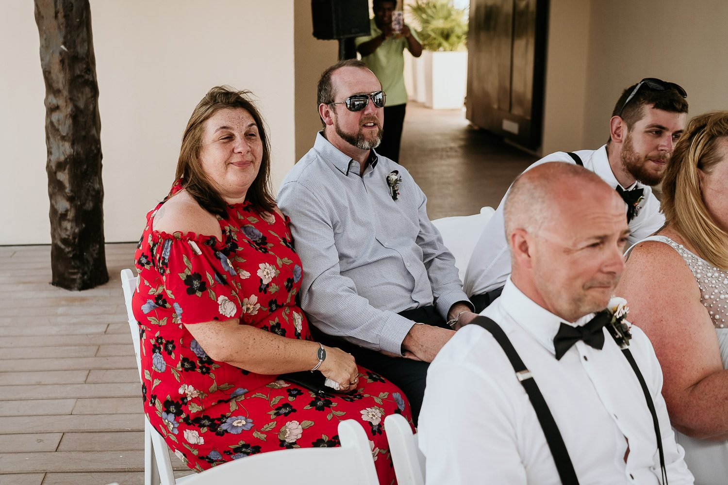 emotional wedding guests watching wedding ceremony