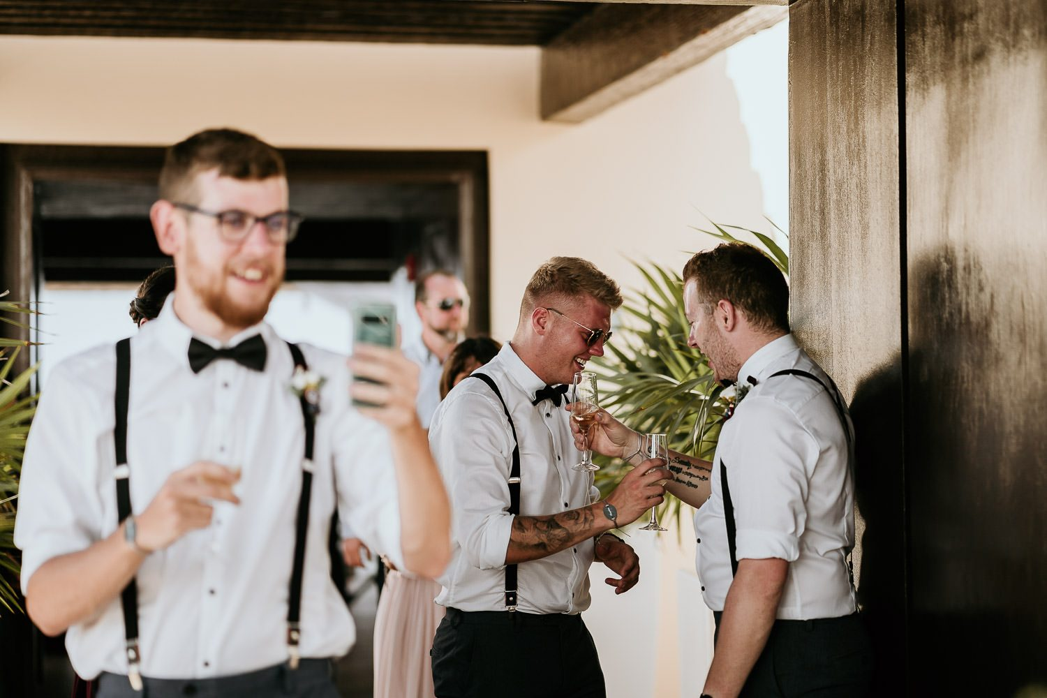 groomsmen laughing after wedding ceremony