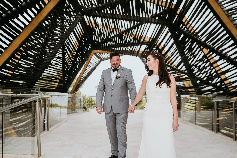 bride and groom walking through the royalton riviera gazebo