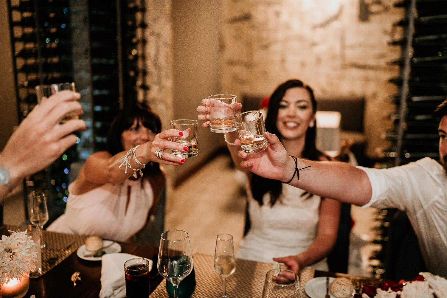 wedding guest cheers with tequila during royalton riviera wedding