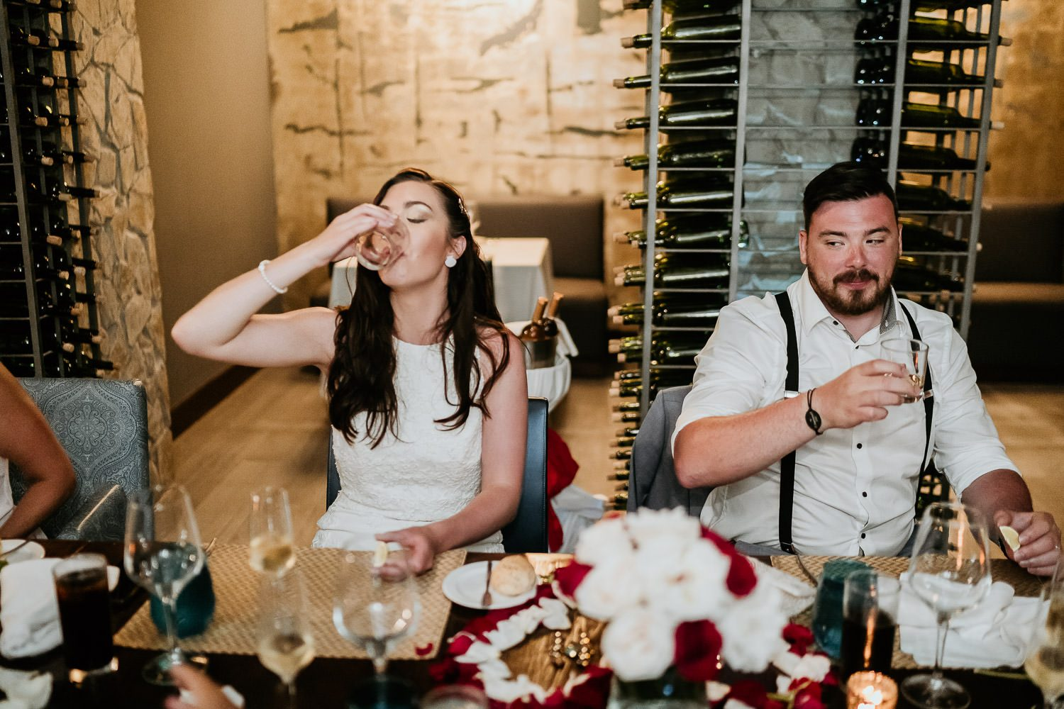 bride and groom having tequila shots during destination wedding in mexico