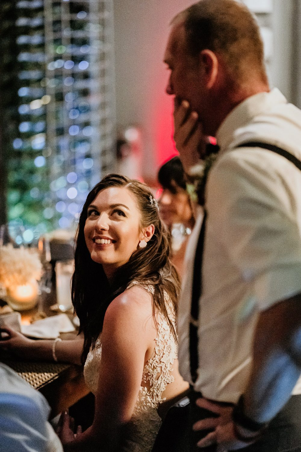 bride smiling at father of bride during wedding speech in cancun destination wedding
