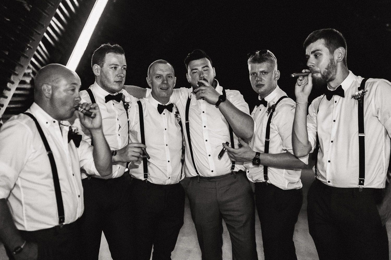 groom and groomsmen smoking cigars at royalton riviera