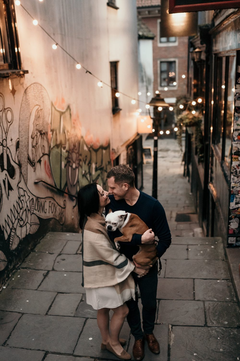 bride and groom kissing during alternative wedding photographs in bristol