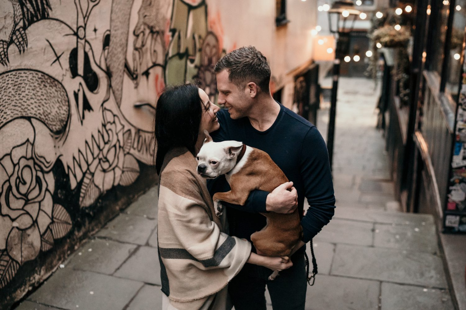bride and groom hugging boston terrier during bristol engagement shoot