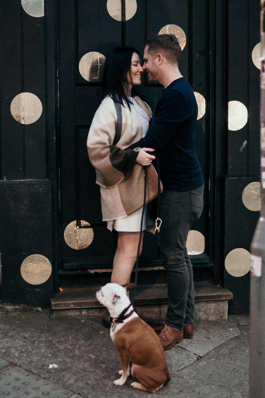 alternative couple cuddling during bristol engagement shoot
